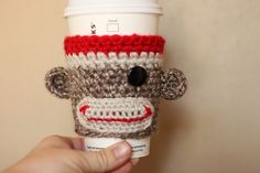 sock monkey coffee cozy  I want this soooo bad!!! If someone game me this, I would be so excited I wouldnt know what to do with myself!!!! I need to learn to make it ;)
