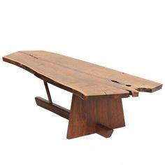 low walnut table; by George Nakashima