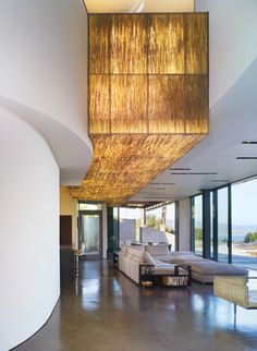 GRIFFIN ENRIGHT ARCHITECTS: Point Dume Residence  translucent resin panel embedded with bear grass and added backlighting to create a 35-foot-long luminous sculpture.
