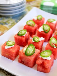 Beautiful! Spicy, salty, sweet watermelon bites! Juicy watermelon, slices of serrano chile and crumbled feta cheese!