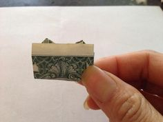For best results, use a crisp (new) bill which will hold the folds better. Fold diagonally, doesn't matter which side. Fold diagonally again in other direction. Origami Star Paper, Money Origami, Origami Boxes, Money Lei, Oragami, Diy Paper, Dollar Heart Origami, Easy Dollar Bill Origami, Origami Tooth