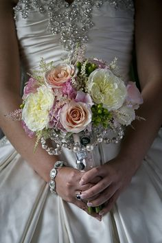 beautiful bouquet - but would like nicer with a dress with cleaner lines.