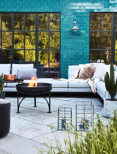 Garden room dining Outdoor garden room complete with turquoise tiles and comfy chairs. A fire pit in the middle. Outdoor Garden Rooms, Garden Spaces, Outdoor Spaces, Outdoor Gardens, Outdoor Sofa, Outdoor Living, Outdoor Furniture Sets, Outdoor Decor, Outdoor Ideas
