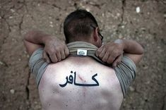 The prevalence of provocative tattoos among US forces should be noted, both in Arabic as in English. A US Army 10th Mountain Division soldier in Wardak Province proudly shows the Arabic word kāfir (كافر), or infidel Infidel Tattoo, Bush Jr, 10th Mountain Division, Military Tattoos, Armed Conflict, Pop Culture References, Islamic World, Maybe One Day, Arabic Words
