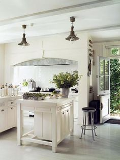 Love the industrial pendants + cooking; white kitchen with touches of gray