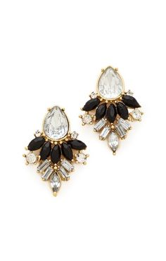 Statement earrings in black, clear, and gold.