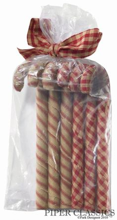 "Candy Canes, set of 6 - Fabric wrapped canes in complementing red and natural colors are a fun addition to holiday décor. 7"" high #prim candy cane #country christmas decoration #primitive xmas ornament"