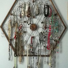 Use metal wall art to hang your jewelry!