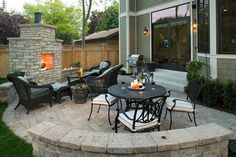 patio with pavers in the color of sierra, fireplace, rattan table set furniture of Spending a Great Time Relaxing in Exceptional Patio