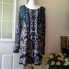 Style & co dress 98 % rayon and 2% other fibers Long sleeves 36 inch long  Very comfortable Style & Co Dresses Mini