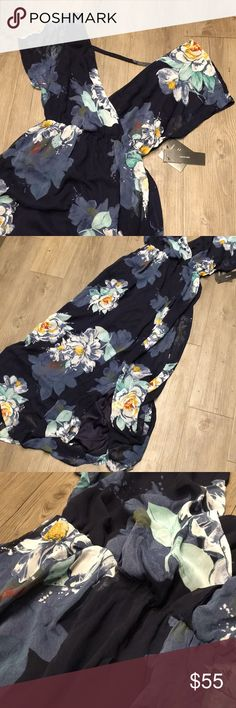 NWT Gorgeous Lulu's Maxi I love this dress but it's too big on me :( Absolutely gorgeous. There is a tie that goes around the waist and a slit in the front. Navy blue floral pattern. Lulu's Dresses