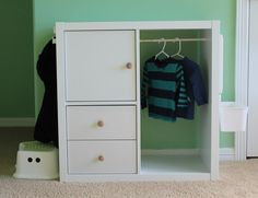 2x2 Kallax hacked into toddler wardrobe (note mirror and basket hanging off the side)