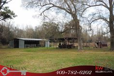 Freshly updated and redone 3 bedroom, 1.5 bathroom, 2 car garage home on over 5 acres! Property features more covered parking with a 2 car carport, and another larger carport area to park your boats, trailers, tractors, etc. The property also has a barn with stalls. Great property right near Hillebrandt Bayou.
