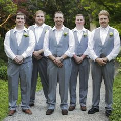 Real Weddings - In Bliss Weddings Brad stands with his groomsmen, all wearing matching grey tuxedos from Al's Formal Wear. Brad wore his favorite pair of cowboy boots for the occasion. http://roxyheartvintage.com