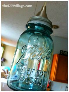 Ball Jar Pendant Light would look oh-so-country chic in your kitchen. (@ the DIY village)