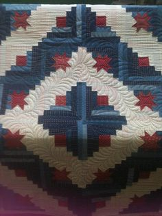 Log Cabin quilt with star block centers made by Janeejan, Midland TX. Quilted by Charisma. Click to view large image