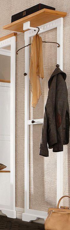 Garderobenpaneel »Fiesta« im edlen Landhaus-Stil. Aus FSC®-zertifiziertem Holz, hochwertig verarbeitet. Front und Oberboden aus massiver Pappel, Korpus aus MDF und furnierter Spanplatte. Wahlweise weiß/honigfarben oder kolonialfarben lackiert. Mit aufwendigen Fräsungen. Zur Wandmontage. Mit einer Hutablage, Maße (B/T): 51/26 cm. Darunter eine Kleiderstange aus Holz. Mit 4 Kleiderhaken aus Metal...