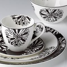 In the Dogwood Point pattern, dramatic black-and-white florals create a kaleidoscope effect. Mix and match with Nag's Head and Pinney's Beach patterns. Crafted of fine bone china, Dogwood Point is safe to use in the microwave and dishwasher.