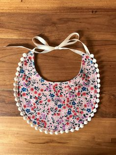Floral infant bib by cottoncakeshop on Etsy