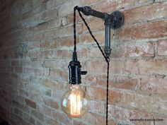 Industrial Wall Sconce - Pendant Edison - Hanging Lamp - Edison Bulb - Wall Light by newwineoldbottles on Etsy https://www.etsy.com/listing/231828152/industrial-wall-sconce-pendant-edison