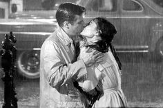 An iconic kiss- and trench coats!  Audrey Hepburn and George Peppard, wearing Burberry trench coats, in 'Breakfast at Tiffany's'