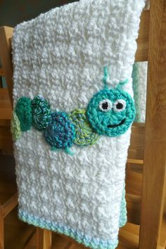Inspiration :: Caterpillar Baby Blanket - cute!  *UPDATE: I made this on my own using the Sedge blanket pattern (http://handverkskunst.is/sedge-blanket-pattern/ ) & adding simple circles for the caterpillar with the embroidered legs & face; it was the hit of the baby shower  :-)    . . . .   ღTrish W ~ http://www.pinterest.com/trishw/  . . . . #crochet #afghan #throw