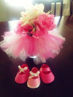 Tutu vase centerpiece for a baby shower.