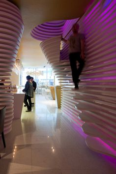 Staircase that grows out of the wall!  Sushicafé Avenida by Saraiva + Associados.