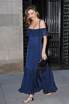 Miranda Kerr looks beautiful in a deep blue off-the-shoulder Gucci maxi dress and side-swept tresses.