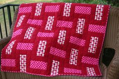 3-color quilt (or you could just use 2 colors). Sew 3 WOF strips together, subcut into squares and arrange every other one vertical/horizontal