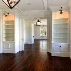 STUDY | Shiplap Wrapped Foyer Entry Leads to Study / Library and Dining Room | Southern | White | Walnut Plank Floors | Lantern Lit Foyer .