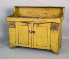 Pennsylvania painted drysink, 19th c., retaining a yellow surface, 40.5 H. x 50.25 W.
