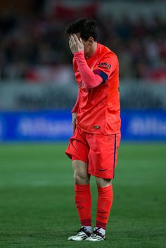 Lionel Messi of FC Barcelona reacts after being tackled during the La Liga match between Sevilla FC and FC Barcelona at Estadio Ramon Sanchez Pizjuan on April 11, 2015 in Seville, Spain.