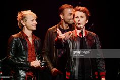 Dominic Howard, Chris Wolstenholme and Matt Bellamy of Muse accept the Best Act in the World Today award The Stubhub Q Awards 2016 at The Roundhouse on November 2, 2016 in London, England.
