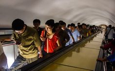'The Pyongyang Metro is the deepest metro system in the world at more than 360ft below ground, conveniently doubling as a nuclear bunker, just in case. It's an almost four-minute descent to reach the train platforms, and, to the top and bottom of the escalators, the hallways are protected by thick steel blast doors,' Mr Davies explains