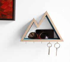Mountain Key Rack and Entryway Organizer This 5 hook mountain key rack and entryway organizer is individually handmade from poplar wood and is wide enough to hold wallets, watches and phones. Choose f