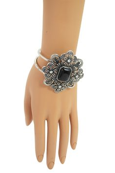 Very pretty vintage design metal flower with colorful semi natural stone accent bangle bracelet. It features very intricate metal casting center piece accented with a semi natural stone in the center.