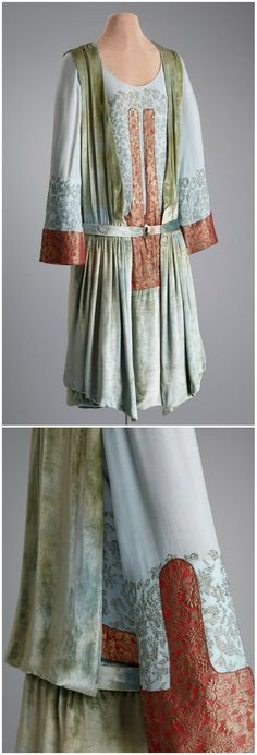Afternoon dress, by Thurn, New York, 1920-1923, via Hillwood Estate, Museum & Gardens. Tubular, drop waisted afternoon dress with three-quarter length, bell-shaped sleeves. Bands of cotton and metallic gold thread in a brocade design decorate the waist and sleeves. Decorative bands of pleated velvet extend from shoulder to dropped waist. The gathered, silk velvet skirt is lined with a blue gauze silk crêpe.