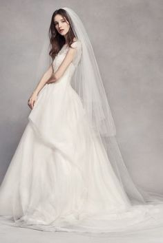 Two layers of soft tulle overlap to create a stunning and elegant effect on this…