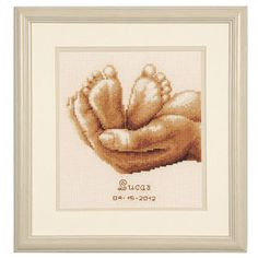 "Loving Hands Tiny Feet  LOVING HANDS cradle baby's tiny feet in this exquisite counted cross stitch. Kit includes 18-count ecru Aida cloth, presorted DMC cotton floss, needle, chart, alphabet and instructions. 6 1/2"" x 7 1/2"" without mat and frame. Imported from Belgium. A Stitchery exclusive!	      ****   Loving Hands Tiny Feet  Item #: T30380  Price: $32.99"