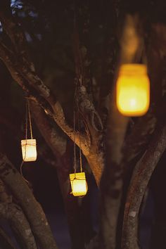 painted mason jars hung in trees