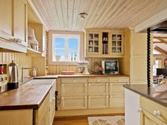 Wooden kitchen from Sweden comes in a rustic country house style.