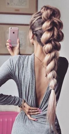 Wonderful big braid on rose blonde hair