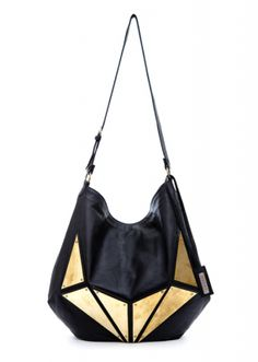 Geometric gold detailing is an awesome touch to a black leather bag!