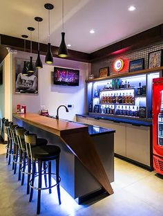 Installing a bar in your home is a great way to make sure that when you have company over everybody has a fun place to spend time together. A dedicated bar spac Basement Bar Designs, Home Bar Designs, Basement Ideas, Mini Bars, Man Cave Bar, Apartment Bar, Apartment Ideas, Home Bar Areas, Modern Home Bar