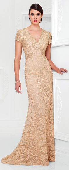 Lace A-line gown with hand-beaded illusion scalloped short sleeves, beaded V-neckline, beaded inverted empire waistline, keyhole back, slight sweep train.