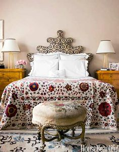 Jonathan Berger was inspired by an 18th-century Venetian bed when designing the intricate headboard in this master bedroom.