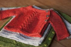 A baby cardigan in three sizes.