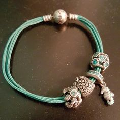 Pandora bracelet Pandora string bracelet, including charms.   Charms include: Hanging seahorse Teal crystal wrapped Pineapple Starfish wrapped  RARELY worn! Pandora Jewelry Bracelets