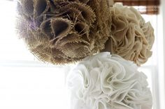 Burlap pompoms. Might have to think about doing something like this.
